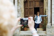 Mature woman posing for photograph, Tuscany, Italy - ISF13440