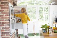 Woman preparing meal in kitchen - ISF13635