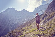 Mature woman, hiking down mountain, Ehrwald, Tyrol, Austria - ISF13671