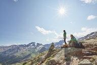 Young hiking couple looking out at Val Senales Glacier, Val Senales, South Tyrol, Italy - ISF13689