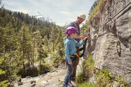 Father and child rock climbing, Ehrwald, Tyrol, Austria - ISF13728