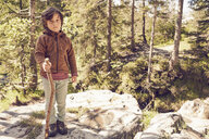 Portrait of young boy in forest, standing on rock - ISF13743