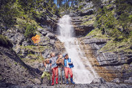 Group of children exploring by waterfall - ISF13752