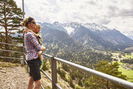 Mother and son looking at mountain view, Garmisch-Partenkirchen, Bavaria, Germany - ISF13854