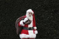 Santa Claus carrying sack over shoulder - CUF33224