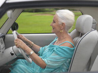 Glamorous senior woman driving in car - CUF33236