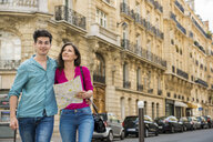 Young couple with map, Paris, France - CUF33245