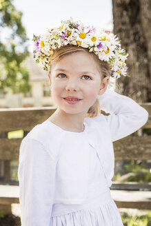 Portrait of young bridesmaid with floral headdress - CUF33254