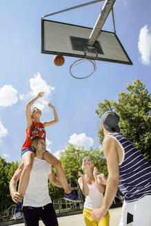 Group of friends having fun playing basketball - CUF33350