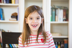 Portrait of happy little girl at home - LVF07129