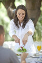 Wife serving salad to husband - CUF33511