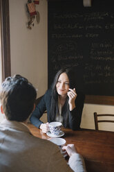 Elegant couple talking in a cafe - ALBF00547