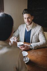 Elegant couple talking in a cafe - ALBF00550