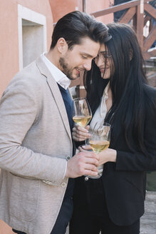 Elegant affectionate couple drinking wine in the city - ALBF00559