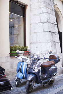 Two old motor scooters parking in front of a house - ABIF00640