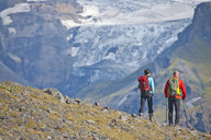 Couple hiking up to Fimmvordurhals Pass above Thorsmork Valley, Thorsmork, South Iceland, Iceland - CUF33729