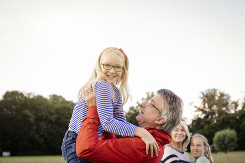 Grandfather lifting granddaughter - CUF33750