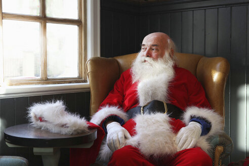 Santa Claus taking break in armchair - CUF33768