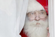 Santa Claus looking out of window - CUF33771