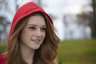 Outdoor portrait of a teenage girl in red hood - CUF33798