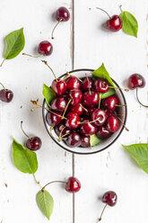 Bowl of cherries on white wood - SARF03798