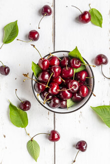 Bowl of cherries on white wood - SARF03798