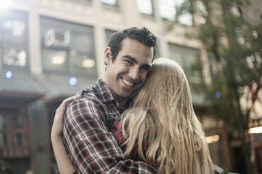 Happy young couple hugging on street, New York City, USA - CUF33967