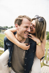 Portrait of happy couple having fun outdoors - UUF14296