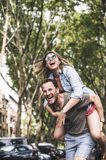 Portrait of carefree couple having fun outdoors - UUF14323
