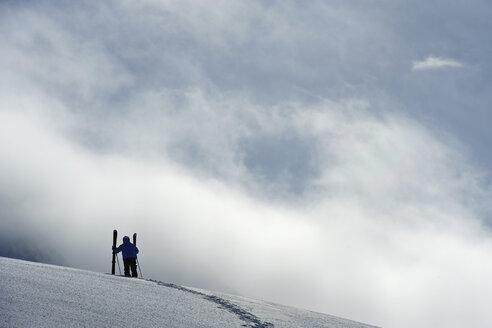 Mid adult male skier standing on hill, Obergurgl, Austria - CUF34079