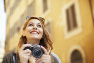 Young woman with digital camera, Rome, Italy - CUF34313