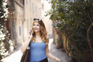 Young woman strolling on quaint street, Rome, Italy - CUF34319