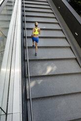 Jogger running up steps - CUF34427