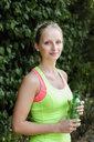 Young female runner taking a break in park - CUF34433