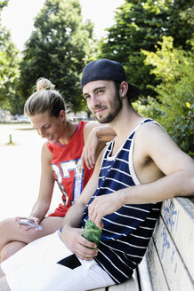 Two basketball friends taking a break in park - CUF34442