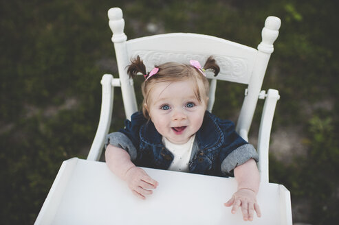 Portrait of baby girl in high chair - ISF14361