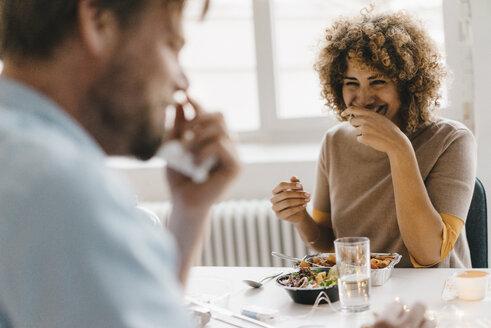 Colleagues joking at lunch break, eating healthy food - KNSF04113