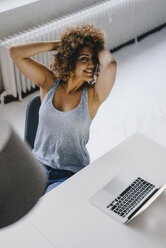 Woman working overtime in her start-up business - KNSF04182