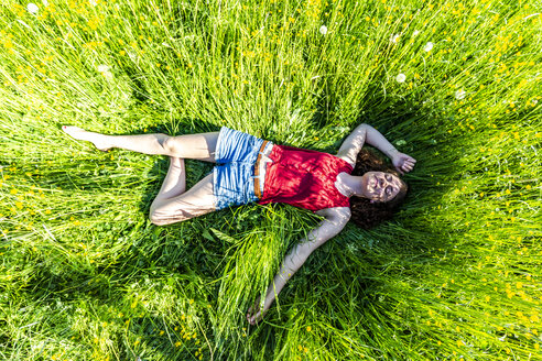 Young woman relaxing in meadow - SARF03803