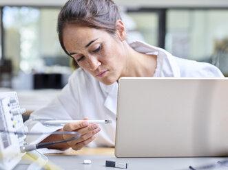 Female technician working in research laboratory - CVF00887