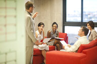 Young businessman presenting ideas to colleagues - CUF34556