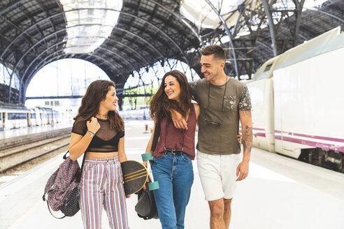Happy friends on train station platform - WPEF00440