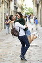 Affectionate happy tourist couple having fun in the city - JSMF00332
