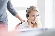 Woman wearing headset - CUF34717