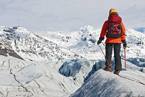 Mature female climber on glacier, Svinafellsjokull, Vatnajokull National Park, Iceland - CUF34735