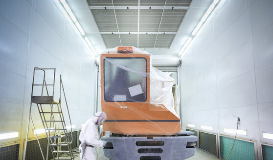 Technician paint spraying in truck repair factory - CUF34933