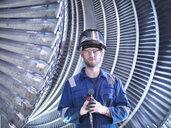 Portrait of apprentice engineer in steam turbine repair workshop - CUF34972