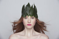 Young woman wearing crown of leaves - CUF35143