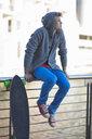 Young man gazing from riverside railings - CUF35212