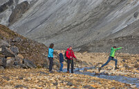 Family crossing the river next to Graenagil at  Landmannalaugar, Fjallabak, Iceland - CUF35242